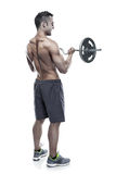 Muscular bodybuilder guy doing exercises with big dumbbell over Royalty Free Stock Photo