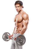 Muscular bodybuilder guy doing exercises with big dumbbell Royalty Free Stock Photo