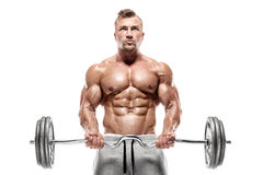 Muscular bodybuilder guy doing exercises with big dumbbell Stock Images