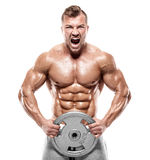 Muscular bodybuilder guy doing exercises with dumbbell Royalty Free Stock Images