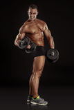 Muscular bodybuilder guy doing exercises with dumbbells Stock Photos