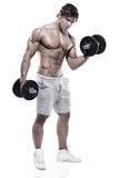 Muscular bodybuilder guy doing exercises with dumbbells Stock Image
