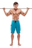 Muscular bodybuilder guy doing exercises with dumbbells over whi Stock Image