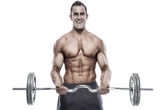 Muscular bodybuilder guy doing exercises with dumbbells over whi Royalty Free Stock Photo