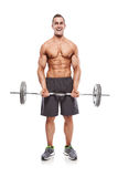Muscular bodybuilder guy doing exercises with dumbbells over whi Stock Photos