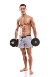 Muscular bodybuilder guy doing exercises with dumbbells Stock Photography