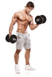Muscular bodybuilder guy doing exercises with dumbbells Royalty Free Stock Image