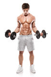 Muscular bodybuilder guy doing exercises with dumbbells Royalty Free Stock Photos