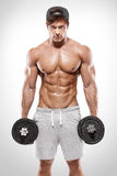 Muscular bodybuilder guy doing exercises with dumbbells Royalty Free Stock Photo