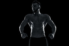 Muscular bodybuilder guy doing posing Royalty Free Stock Photo