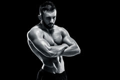 Muscular bodybuilder guy doing posing Stock Photo