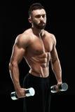 Muscular bodybuilder guy doing posing Royalty Free Stock Photos