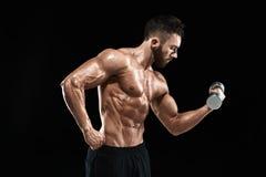 Muscular bodybuilder guy doing posing Stock Images