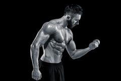 Muscular bodybuilder guy doing posing Stock Photography