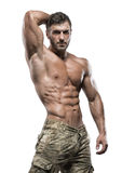 Muscular bodybuilder guy isolated over white background Royalty Free Stock Photo