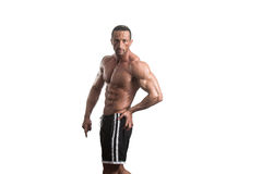 Muscular Bodybuilder Guy Posing Over White Background Royalty Free Stock Photos