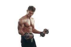 Muscular bodybuilder man doing exercises with dumbbells Stock Photos