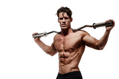Muscular bodybuilder man doing exercises. Isolated over white background Royalty Free Stock Image