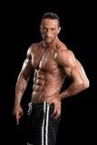Muscular Bodybuilder Man Posing Over Black Background Royalty Free Stock Photos