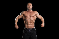 Muscular Bodybuilder Man Posing Over Black Background Royalty Free Stock Photo