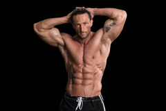 Muscular Bodybuilder Man Posing Over Black Background Stock Images