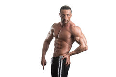 Muscular Bodybuilder Man Posing Over White Background Royalty Free Stock Photo