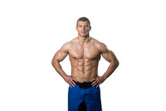 Muscular Bodybuilder Man Posing Over White Background. Young Muscular Man Posing In Studio Showing Abs - Isolated On White Background Stock Photography