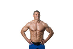 Muscular Bodybuilder Man Posing Over White Background. Young Muscular Man Posing In Studio Showing Abs - Isolated On White Background Stock Photo
