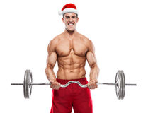 Muscular bodybuilder Santa Claus doing exercises with dumbbells Royalty Free Stock Image