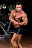 Muscular bodybuilder showing his side chest. Muscular body builder showing his side chest Royalty Free Stock Images