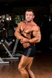 Muscular bodybuilder showing his side chest. Muscular body builder showing his side chest Stock Images