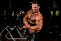 Muscular bodybuilder showing his side chest. Muscular body builder showing his side chest Stock Photo