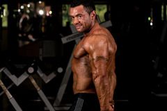 Muscular bodybuilder showing his side triceps Stock Photo