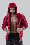 Muscular bodybuilder undressing Royalty Free Stock Photos