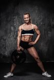 Muscular bodybuilder woman Royalty Free Stock Photo