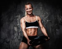 Muscular bodybuilder woman Royalty Free Stock Photography