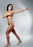 Muscular bodybuilder woman showing her muscles. Stock Photos