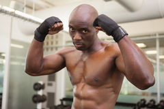 Muscular boxer in defensive stance in health club Royalty Free Stock Photo