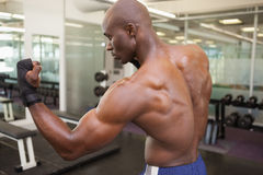 Muscular boxer in defensive stance in health club Stock Photo