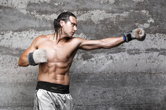 Muscular boxer man punching Stock Photo