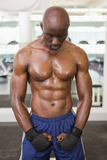 Muscular boxer standing in health club Stock Photography