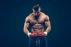 Muscular boxer in studio shooting, on black. Background Royalty Free Stock Photo