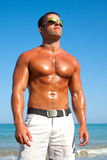 Muscular brutal man on the beach Royalty Free Stock Photography