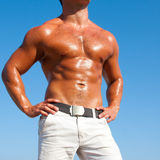 Muscular brutal man on the beach Stock Image