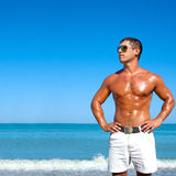 Muscular brutal man on the beach Stock Photography