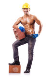 Muscular builder with bricks Royalty Free Stock Photos