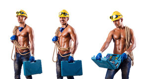 The muscular builder with tools isolated on white Royalty Free Stock Photo
