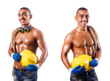 The muscular builder with tools isolated on white Stock Images