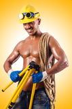 Muscular builder with tools Stock Photos