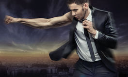 Muscular businessman defeating his issues Stock Photo